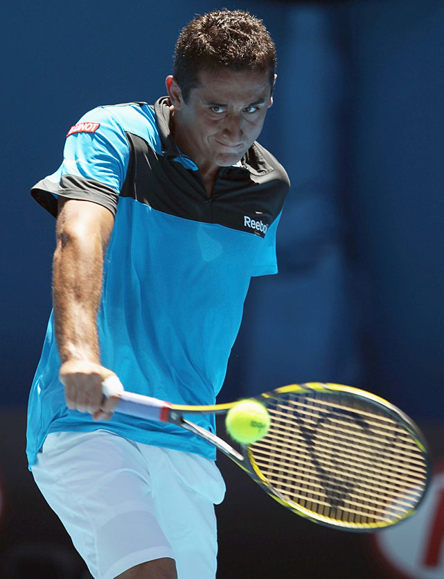 Almagro plays a backhand to Djokovic during Saturday's match.