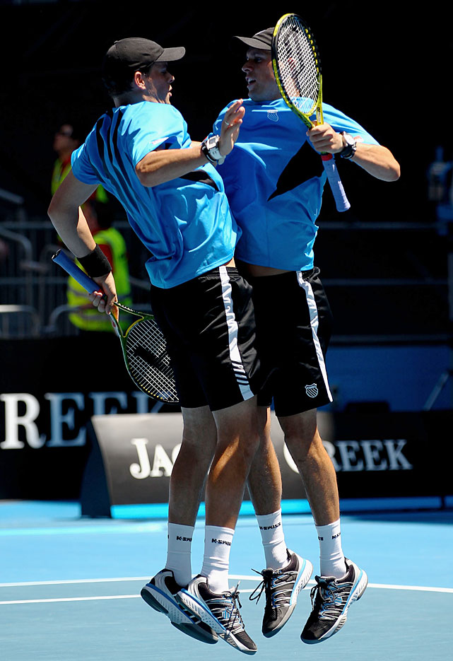 Bob Bryan and Mike Bryan of the United States of America celebrate match point of their third-round doubles match against Benjamin Becker of Germany and Michael Kohlmann of Germany.