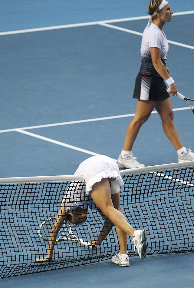 Schiavone falls over the net during her fourth-round match.