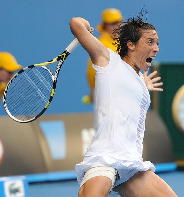 Francesca Schiavone of Italy returns to Svetlana Kuznetsova of Russia during their fourth-round match. Schiavone won 6-4, 1-6, 16-14.