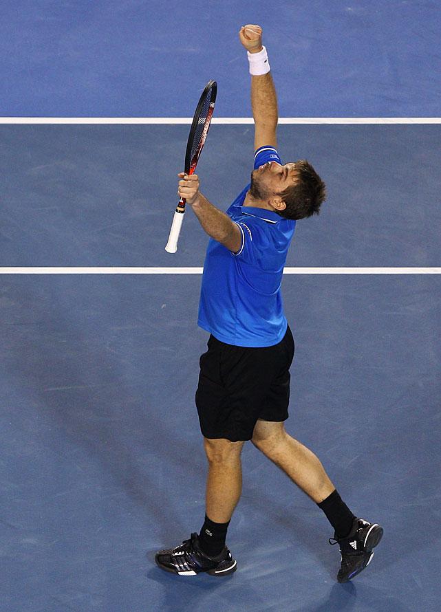 Wawrinka celebrates his 6-3, 6-4, 6-4 win over Roddick.