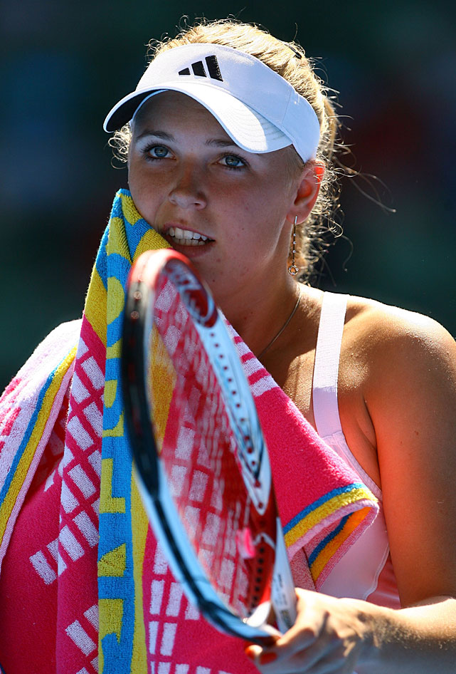 Caroline Wozniacki of Denmark wipes her face with a towel during Saturday's fourth-round match against Latvia's Anastasija Sevastova at Melbourne Park. The top-seeded Wozniacki won 6-3, 6-4 to advance to the quarterfinals, where she will meet Francesca Schiavone.