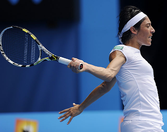 Italy's Francesca Schiavone watches her backhand return to Denmark's Caroline Wozniacki during their quarterfinal match.