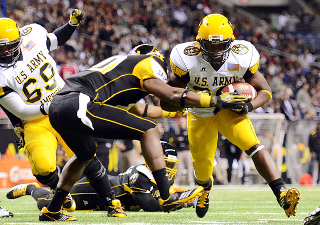 West running back Malcolm Brown (28) is dragged down on a run. The five-Star recruit has committed to play for Texas.
