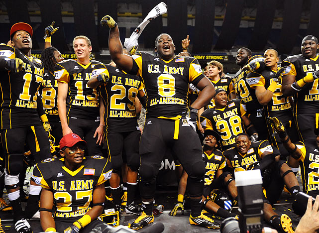 Defensive lineman Timmy Jernigan (8) leads the celebration after the East's narrow victory.