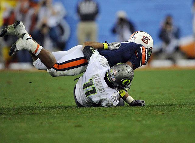 Auburn running back Michael Dyer escapes a tackle in the closing seconds of Monday's BCS title game by landing on top of Oregon's Eddie Pleasant before rolling back to his feet to complete a 37-yard run to put the Tigers in position for a game-ending field goal.