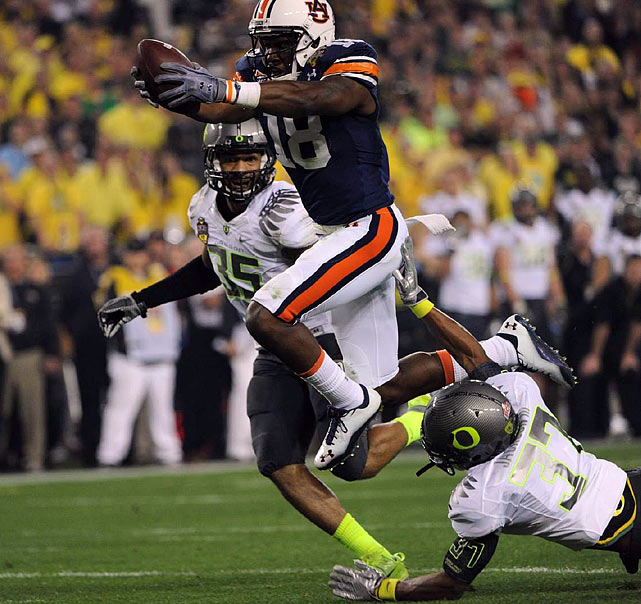 Auburn's Kodi Burns stretches across the goal line for Auburn's first touchdown, a 35-yard pass from Cam Newton.