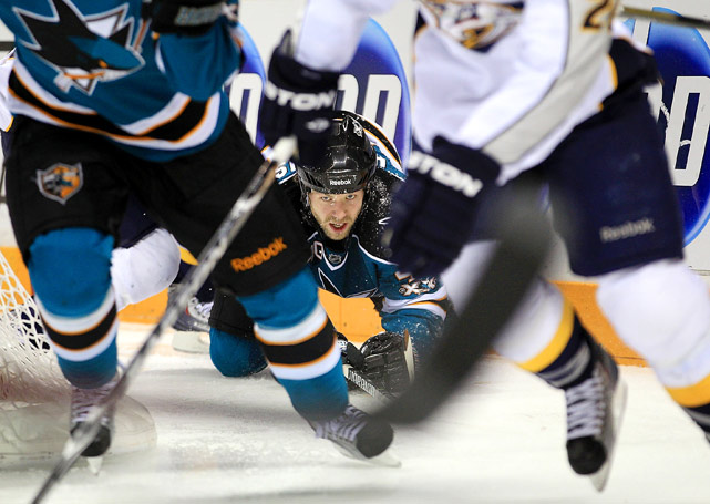 Kent Huskins of the San Jose Sharks watches the action from the ice during their game against the Nashville Predators at HP Pavilion on Jan. 8 in San Jose.  Nashville beat San Jose 2-1.