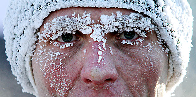 A participant runs during a frosty traditional Russian Orthodox Christmas Half Marathon on Jan. 7 in Omsk, where the temperatures dropped to -30 C.