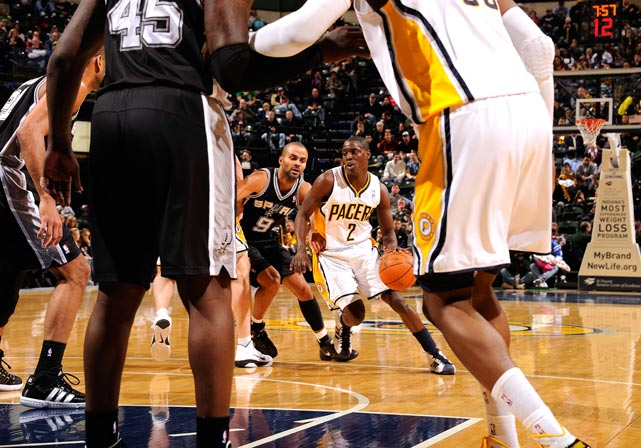 Darren Collison of the Indiana Pacers drives against Tony Parker of the San Antonio Spurs in January 7th game at Conseco Fieldhouse in Indianapolis. The Spurs won 90-87.