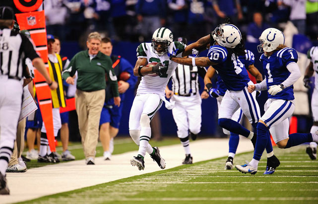 Antonio Cromartie of the New York Jets stiff-arms Taj Smith of the Indianapolis Colts at the end of a kickoff return during the AFC playoffs on Jan. 8 at the RCA Dome in Indianapolis. The Jets won 17-16.