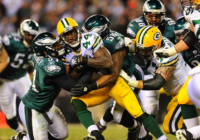 James Starks of the Green Bay Packers gets sandwiched between James Chaney (51) and Trent Cole (58) during a NFC playoff game Jan. 9 at Lincoln Financial in Philadelphia. The Packers won 21-16.