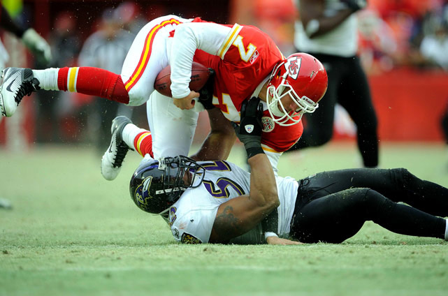 Matt Cassel of the Kansas City is taken down by Ray Lewis of the Baltimore Ravens, in an AFC playoff game on Jan. 9 at Arrowhead Stadium in Kansas City. The Ravens won 30-7.