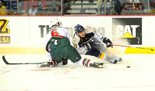 Colin Wilson of Nashville collides with Marco Scandella of the Minnesota Wild during the Predators' 5-1 home win on Jan. 11.
