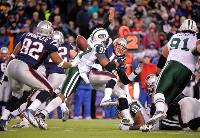 Calvin Pace of the New York Jets takes down Tom Brady of the New England Patriots during the Jets 38-21 victory in an AFC playoff game on Jan. 16 at Gillette Stadium.
