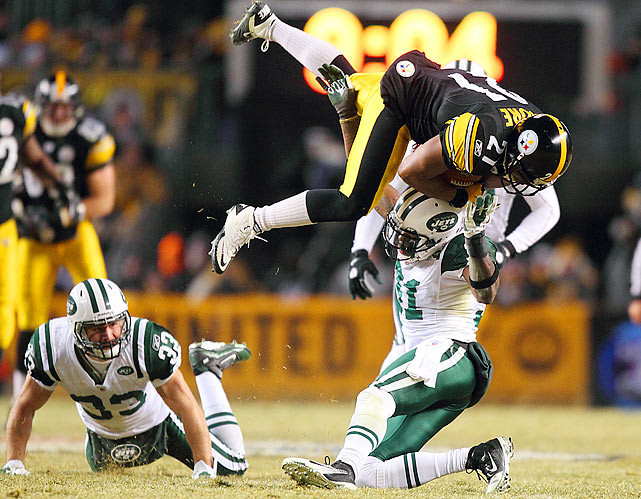 Mewelde Moore of the Pittsburgh Steelers catches a pass over Antonio Cromartie of the New York Jets in the third quarter of their AFC Championship game at Heinz Field in Pittsburgh. The Steelers defeated the Jets 24-19.