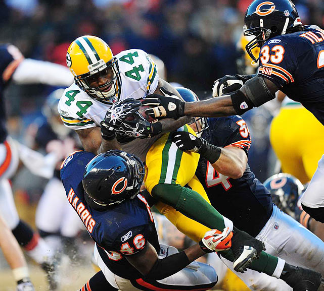Running back James Starks of the Packers helped Green Bay reach the Super Bowl with a 21-14 win over Brian Urlacher (54), Chris Harris (46) and Charles Tillman (33) of the Bears at Soldier Field in Chicago.