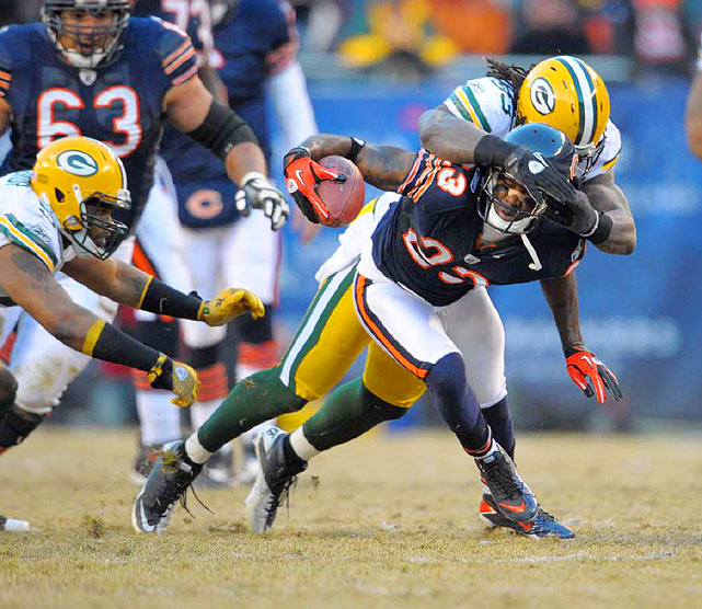 Linebacker Erik Walden (93) of the Packers wrestles Devin Hester (23) of the Chicago Bears to the ground during Green Bay's 21-14 victory in the NFC Championship Game at Soldier Field on Jan. 23.