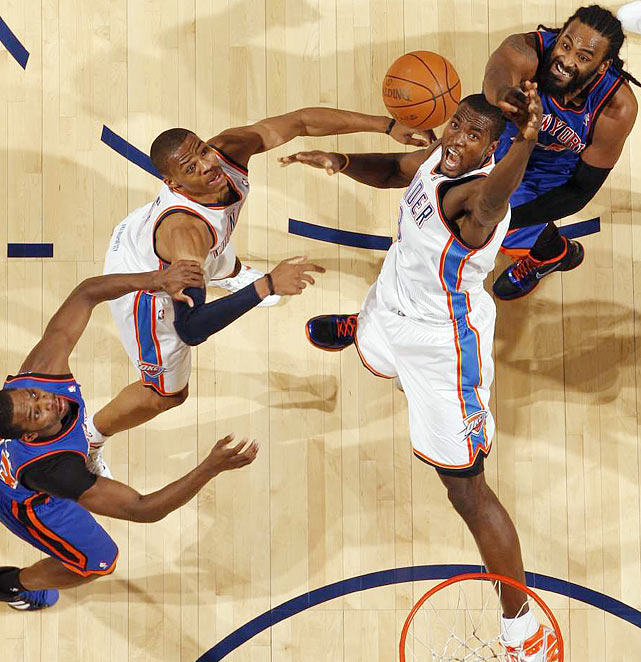 Oklahoma City Thunder forward Serge Ibaka battles for a rebound against Ronny Turiaf of the New York Knicks during a Jan. 22 game at the Ford Center in Oklahoma City.  The Thunder won 101-98.