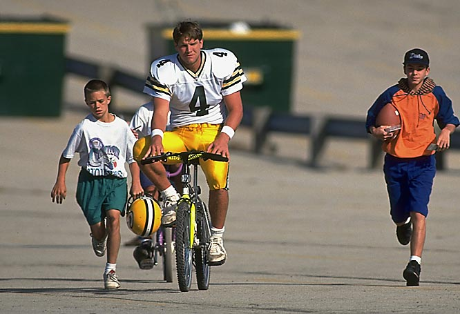 Brett Favre partakes in a Packers tradition by riding a bicycle to practice with fans during training camp in 1993.