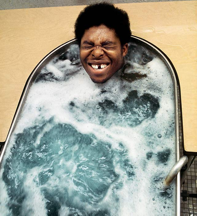 Steelers defensive end Dwight White enjoys a hot tub during training camp on July 28, 1973, at St. Vincent College in Latrobe, Pa. The college has hosted the Steelers training camp for the past 44 years.