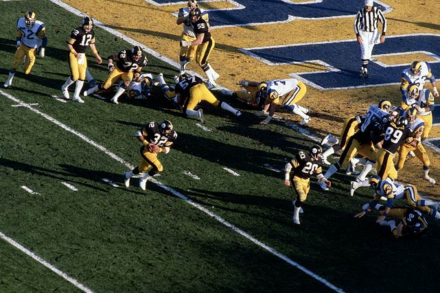 "Running back Franco Harris scores one of his two touchdowns in Super Bowl XIV against the Los Angeles Rams. Best known for his ""Immaculate Reception"" in 1972, Harris was enshrined into the Hall of Fame in 1990 after amassing 12,120 career rushing yards in his 13-year career."