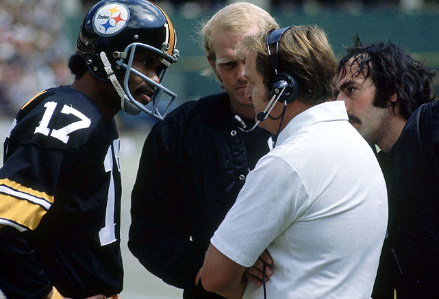 Chuck Noll, the head coach during four of the Steelers six championships, has a discussion with quarterbacks Joe Gilliam (17) and Terry Bradshaw. Noll was inducted into the Hall of Fame in 1993 after winning 16 games in the playoffs and 193 games in the regular season during his 23-year tenure as the Pittsburgh head coach.