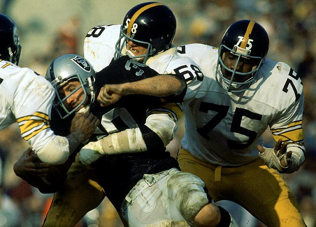 Defenders Mean Joe Greene (75) and Jack Lambert (58) swarm Mark Van Eeghen of the Oakland Raiders during the AFC Championship Game on Dec. 26, 1976, at Alameda County Stadium in Oakland. The Raiders won 24-7, ending the Steelers three-peat bid.