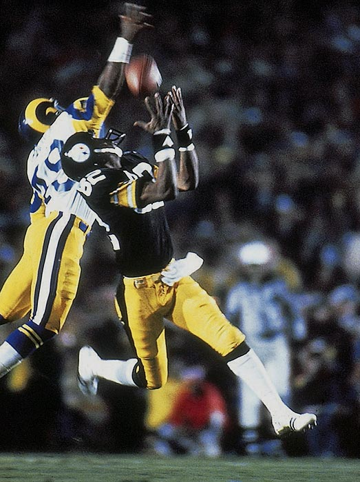 Wide receiver John Stallworth hauls in a 73-yard, go-ahead touchdown at the beginning of the fourth quarter during Super Bowl XIV. The pass barely missed the outstretched hand of Rod Perry.