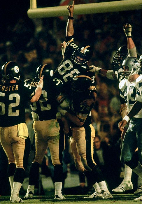 Lynn Swann is lifted by his teammates after scoring a late touchdown in the fourth quarter of Pittsburgh's 35-31 defeat of the Dallas Cowboys in Super Bowl XIII. He was later elected to the NFL's 1970 All-Decade team.