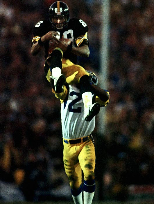Wide receiver Lynn Swann leaps above a Los Angeles Rams defender to secure a catch during Pittsburgh's 31-19 victory in Super Bowl XIV, in 1980.