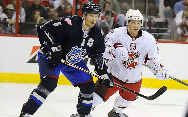 The team captain (left), here battling hometown favorite Jeff Skinner, kept things going with a first-period assist.