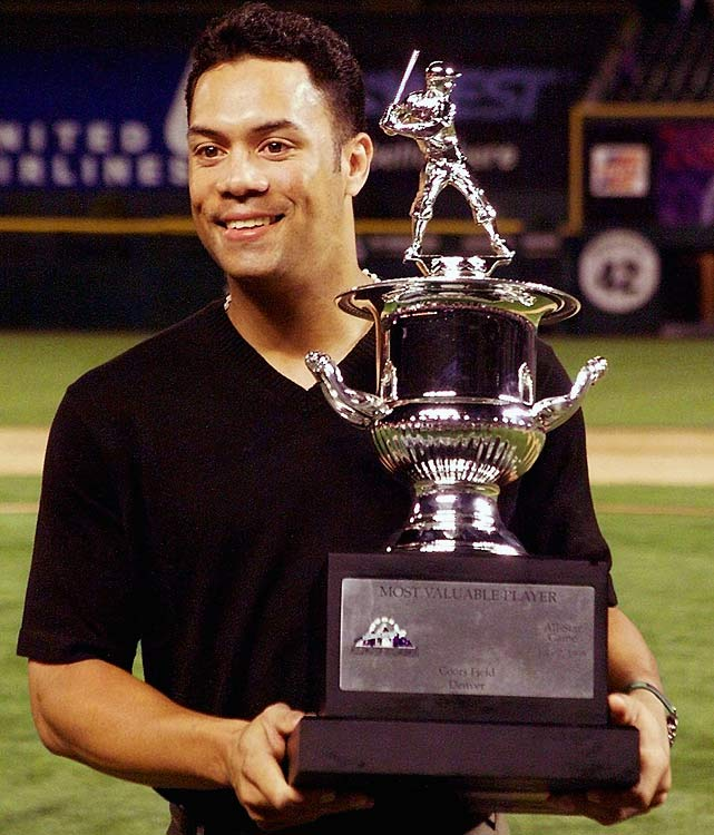 Alomar, then a Baltimore Oriole, with the Most Valuable Player trophy at the 1998 All-Star game at Coors Field in Denver. Alomar hit a home run in the win for the American League, taking home the hardware a year after it had been awarded to his brother.