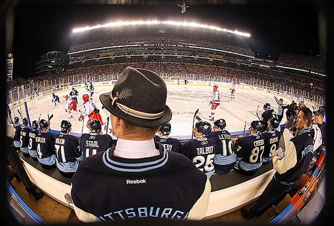 Penguins coach Dan Byslma dressed for the moist conditions by donning a trilby hat behind the bench.