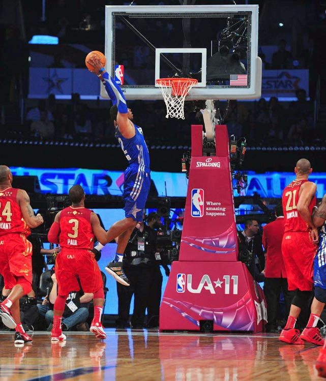 Blake Griffin won the dunk contest, but Dwight Howard showed he's still Superman with this slam in the first half.