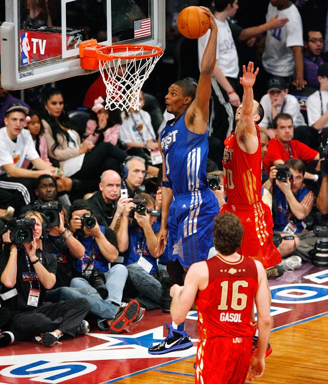 Heat forward Chris Bosh slams home a tomahawk dunk in the first half. Miami's third amigo scored 14 points.