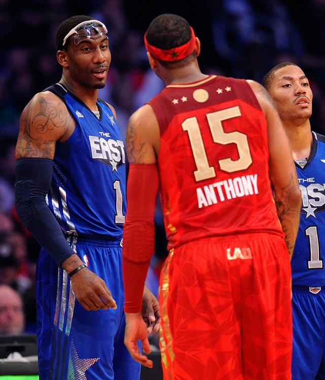 Current opponents (and future teammates?) Amar'e Stoudemire and Carmelo Anthony discuss something during a break in the action Sunday. What could they possibly be talking about?