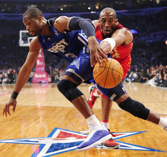 The All-Star game was so good this year that even a little defense was played. Kobe Bryant pokes the ball away from Dwyane Wade in the second half.