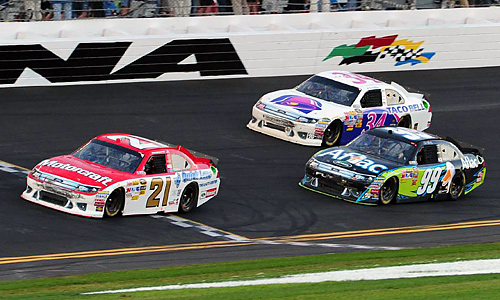 Trevor Bayne took the checkered flag in front of Carl Edwards (99) and David Gilliland (34).