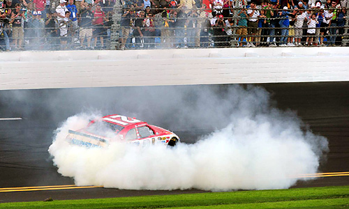 The youngster, who held off Carl Edwards by 0.118 seconds, gave the historic Wood Brothers team its first victory since 2001.