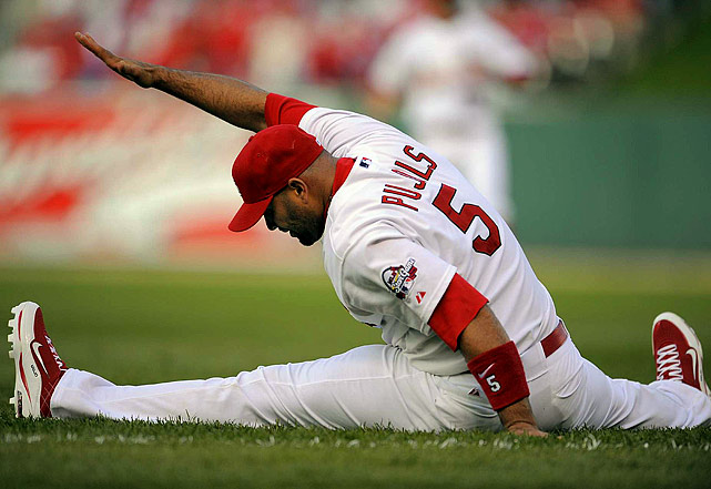 Pujols stretches before Game 3 of the 2009 NLDS against Los Angeles. The Dodgers would go on to sweep the Cardinals in three games as the first baseman managed just three hits and no home runs in the series.