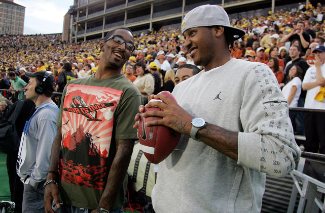 Carmelo and Nuggets teammate J.R. Smith enjoy some down time at the Texas-Colorado football game in Boulder, Colo. in 2008.
