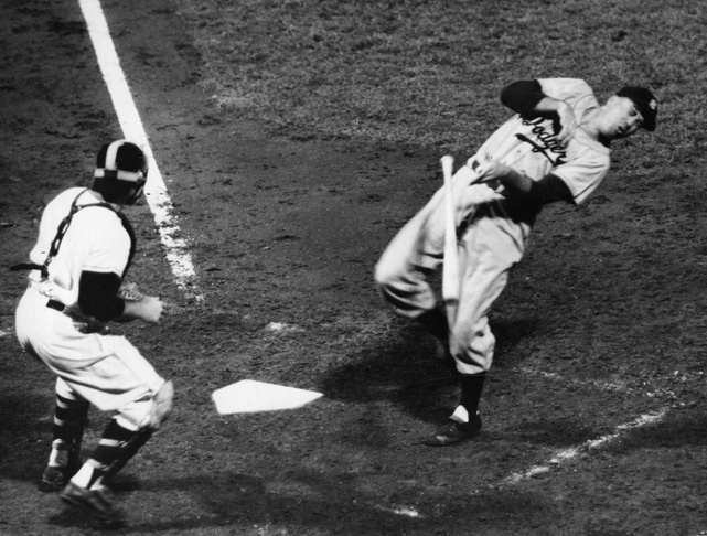 Snider is hit by a pitch in a game against Giants. In 1951, Snider's batting average dropped from .321 (in 1950) to .277 and the Dodgers blew a 13-game division lead in the division. Many fans blamed Snider for the team's collapse and he was nearly traded by team owner Walter O'Malley.