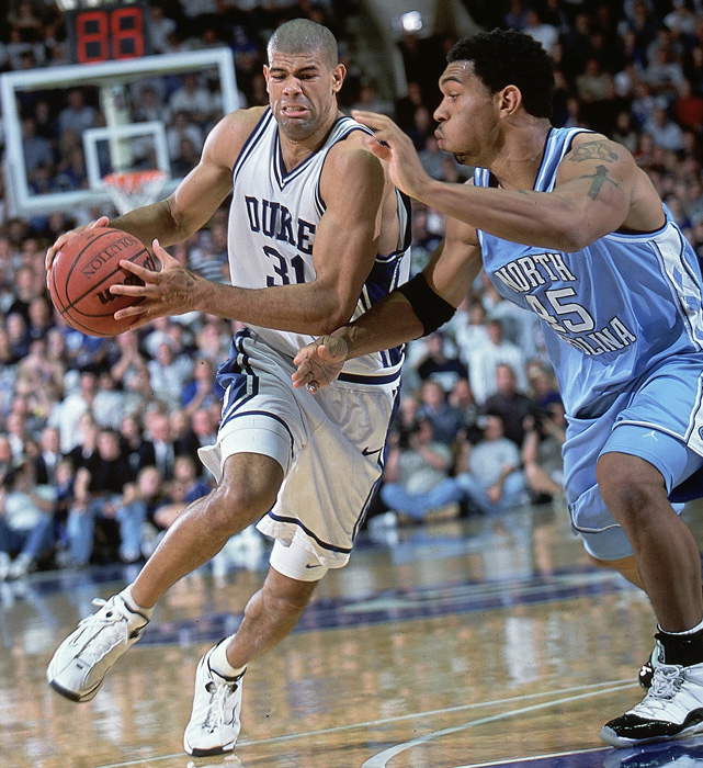 Shane Battier drives past Julius Peppers. Battier won Player of the Year honors in 2001 and led the Blue Devils to the national championship.