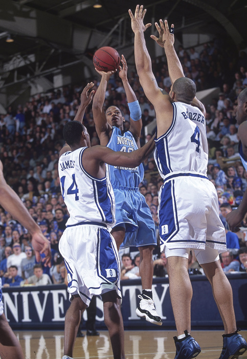 Joseph Forte shoots over Nate James and Carlos Boozer. The UNC guard played two seasons in Chapel Hill, winning 2000 ACC Rookie of the Year and 2001 ACC Player of the Year, before being drafted by the Celtics in 2001. His NBA career lasted only two seasons.
