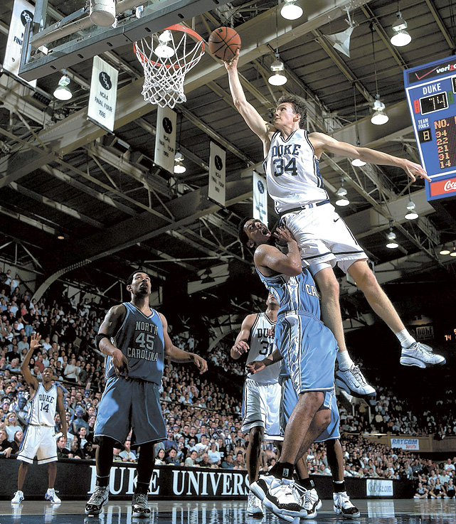 Mike Dunleavy Jr. dunks over Jason Capel. The Duke forward averaged 17 points and 7 rebounds per game in the Blue Devils' 2001 championship season.