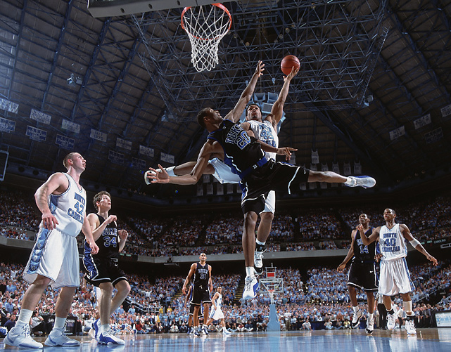 Julius Peppers powers a layup over Casey Sanders. The Bears defensive end was a walk-on for coach Bill Guthridge and a key reserve in the team's run to the 2000 Final Four.