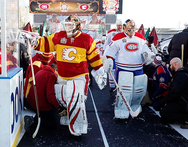 Goalies Miikka Kiprusoff and Carey Price lead their teams onto the ice.