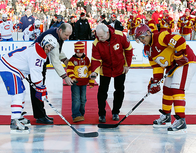 Jarome Iginla and Brian Gionta line up for the ceremonial puck drop.