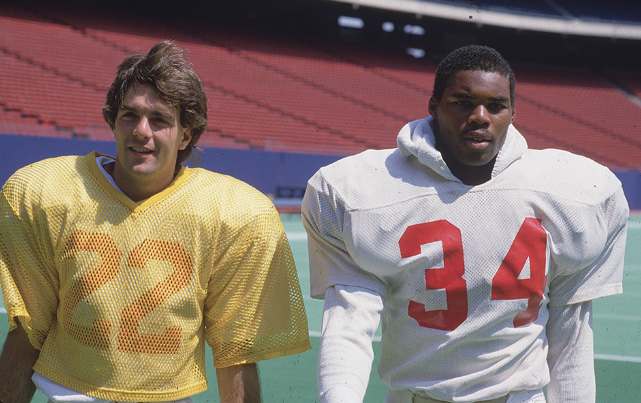 Former Heisman Trophy winners Doug Flutie (22) and Walker (34) practice as members of the USFL New Jersey Generals. Walker led the USFL in rushing in 1983 and '85, when he rushed for an astonishing 2,411 yards in 18 games, a professional football record.